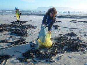 Marion picking up litter at a Beach Clean-up in Muizenberg.